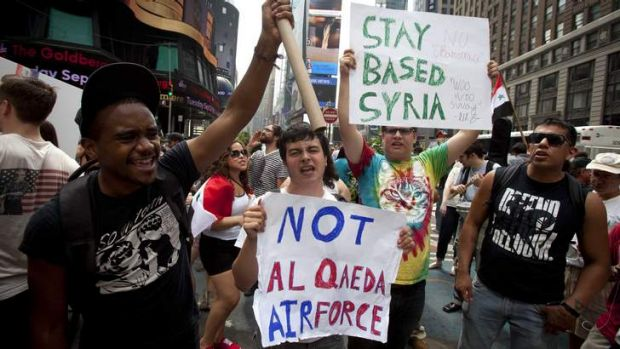 Unpopular: New Yorkers protest against proposed U.S. military action against Syria, in Times Square, August 31, 2013.    ...