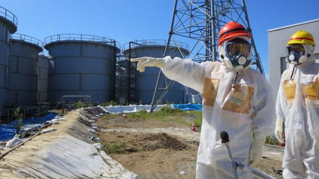 Lethal: Japanese Economy, Trade and Industry Minister Toshimitsu Motegi (left) inspects contamination water tanks at ...