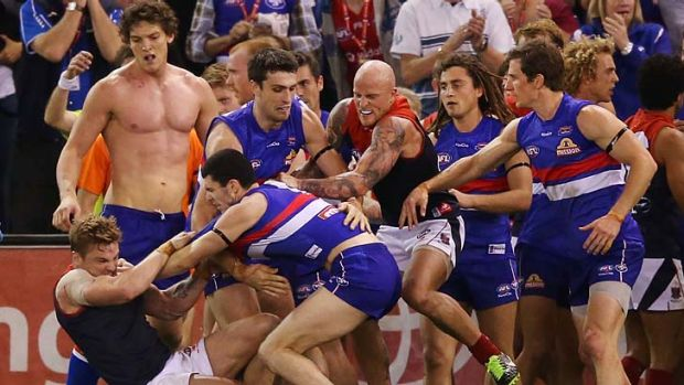 Shirtless: Will Minson looks on during the half-time melee.