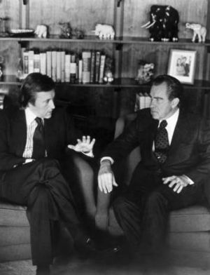 David Frost, left, talks with former President Richard Nixon prior to the taping of his interview with the former President.