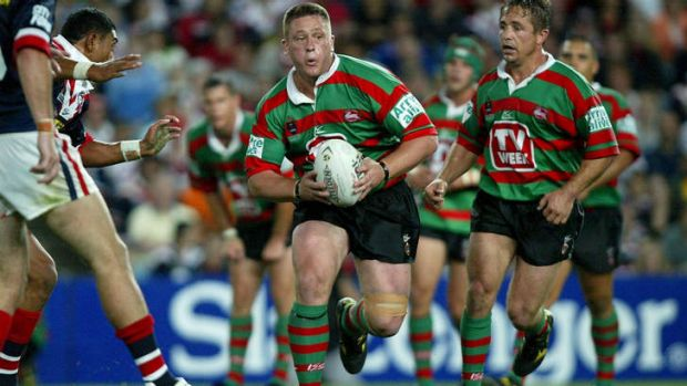 The clash of 2002: Adam Peek takes it up for Souths.