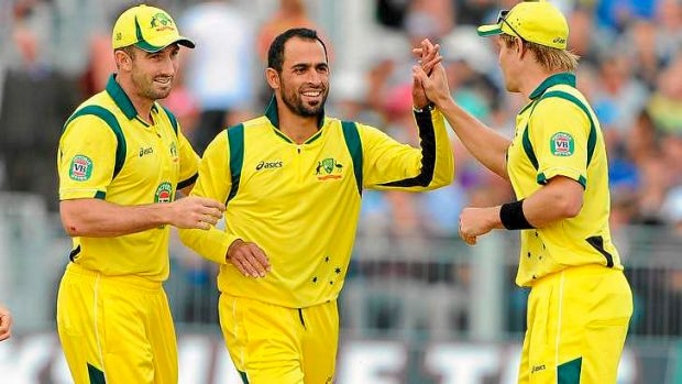 Discomfort: Fawad Ahmed, celebrating after claiming the wicket of England's Michael Lumb, has been allowed to wear an ...