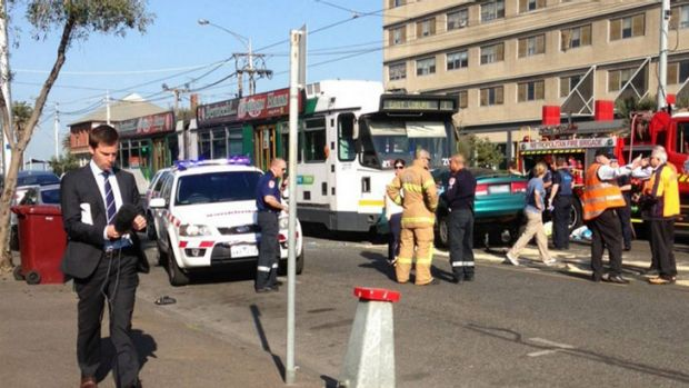 Police say the driver of the sedan was seen swerving over tram lines before the fatal collision.