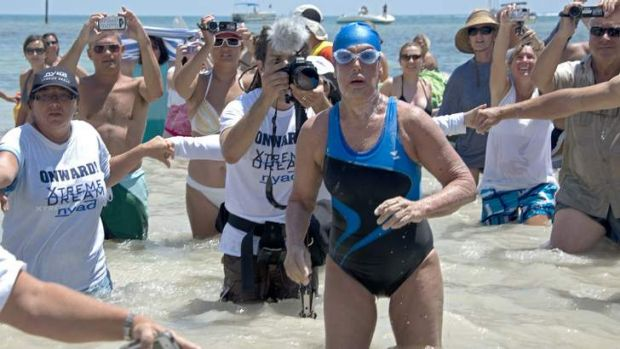 Diana Nyad emerges from the Atlantic Ocean after completing a 180-kilometre swim from Cuba to Key West, Florida.