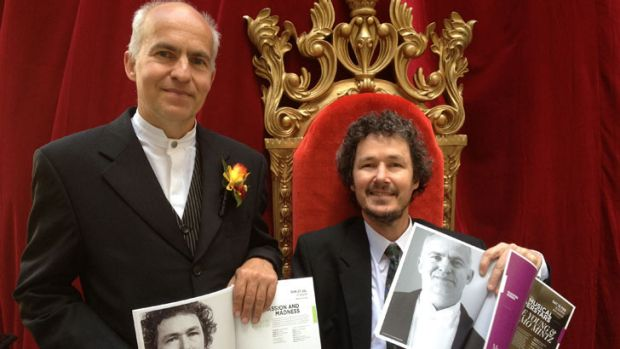QSO chief conductor Johannes Fritzsch and Concert Master Warwick Adeney show off their 2014 season brochures at the ...
