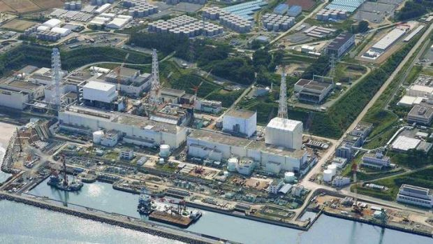 An aerial view shows the Tokyo Electric Power Company's (TEPCO) tsunami-crippled Fukushima Daiichi nuclear power plant ...