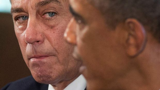 House Speaker John Boehner of Ohio listens as President Barack Obama speaks to media, in the Cabinet Room of the White ...