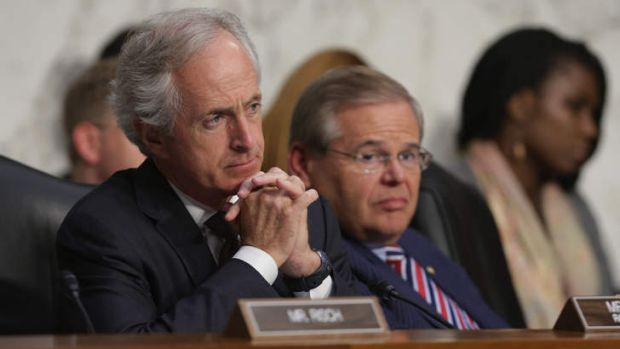 Senate Foreign Relations Committee ranking member Senator Bob Corker (left) and Chairman Robert Menendez (right) listens ...