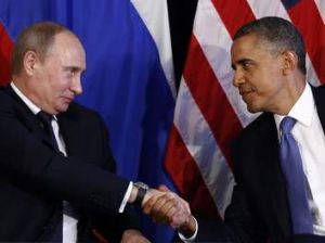Mr Obama and Mr Putin shake hands in Los Cabos, Mexico, last year.