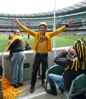 Richmond fan Dugald Jellie in his finery at the MCG.