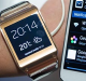 A model displays the new Samsung Galaxy Gear, left, which is connected ivy Gear Watch with the new Samsung Galaxy Note ...