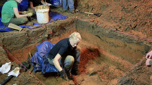 Grim dig: a grave is exhumed at the now closed Arthur G. Dozier School for Boys.