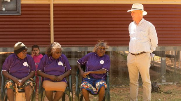 Warren Snowdon talks to local women in the NT community of Lajamanu.