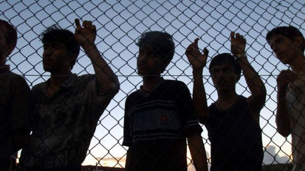 Asylum seekers in the compound at Nauru.