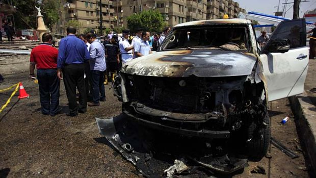 Bomb attack: Security personnel gather at a site of an explosion against the convoy of the Egyptian interior minister ...