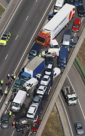Carnage: Around 100-vehicles are involved in the pile-up on a bridge in heavy fog, leaving at least eight people ...
