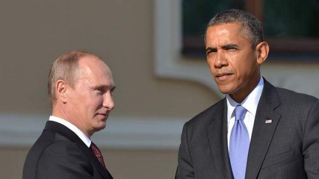 Russian President Vladimir Putin and US President Barack Obama shake hands during an official welcome during the G20 Summit.