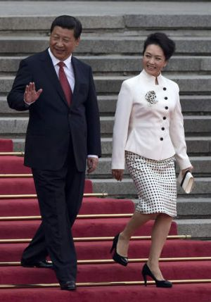 Fighting for frugality: Xi Jinping and his wife Peng Liyuan.