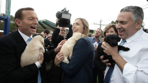 Opposition Leader Tony Abbott looks optimistic ahead of the polls during his visit to Guide Dogs Victoria with his ...