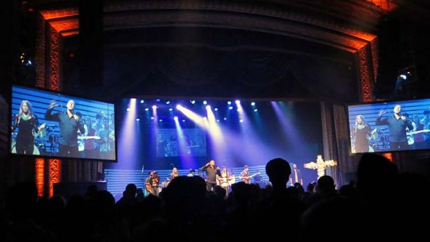 Full house: Hillsong pastor Brian Houston on stage during a service at the Manhattan Centre Grand Ballroom in New York ...