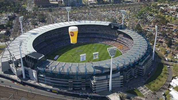 A Carlton Draught hot air balloon flies over the Melbourne Cricket Ground on AFL grand final day.