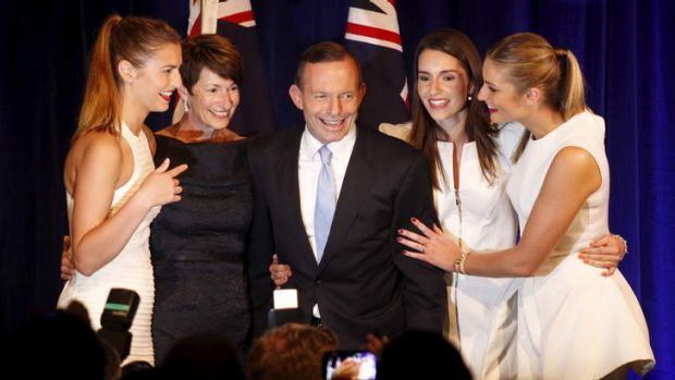 Under new management: Tony Abbott, surrounded by his family, claims victory.