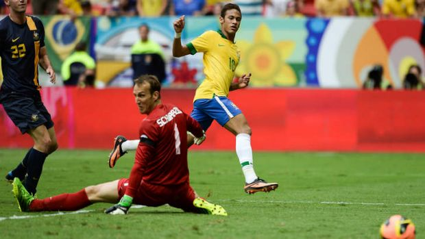 Neymar of Brazil shoots for goal.