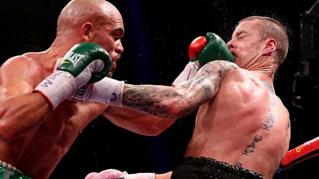 Ricky Burns (R) dislocated his jaw in the second round.