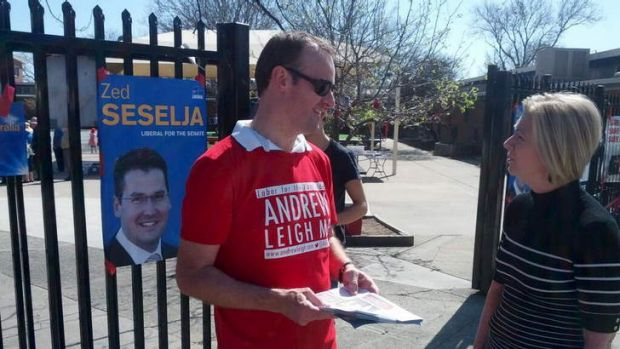 Gloomy outlook ... ACT Treasurer Andrew Barr offers advice to voters at North Ainslie Primary School on Saturday.