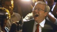 Australian Prime Minister Kevin Rudd reacts as he walks past supporters at a Labor Party function in Brisbane September ...