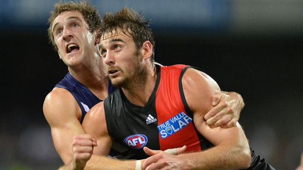 Round 3 flashback... Jobe Watson is tackled by  Michael Barlow at at Patersons Stadium.