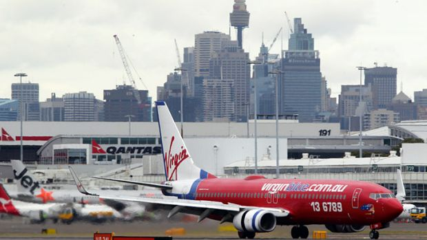 Virgin chief John Borghetti is urging a rethink of flight caps during non-peak periods.