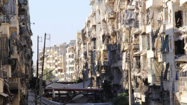 Syria waits to hear if the US will go ahead with missile strikes. In Aleppo,  the devastation from intense fighting is ...