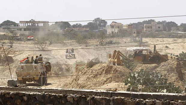 Egyptian soldiers use bulldozers in search of tunnels on the border with Egypt and the Gaza Strip on September 8, 2013.
