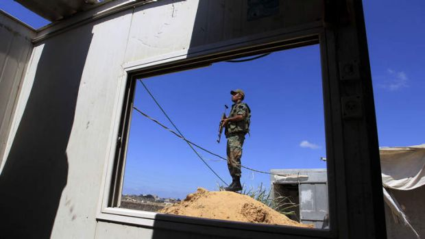 A Hamas policeman stands guard along the border with Egypt and the Palestinian territory.