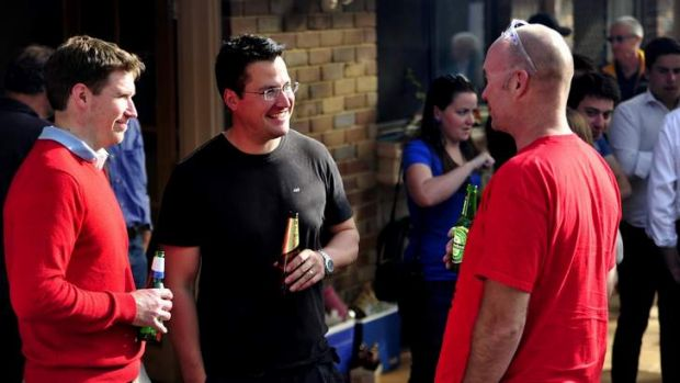 Zed Seselja chats with one of his campaign volunteers - right - Rich Armitage and MLA Alistair Coe at a post BBQ at ...