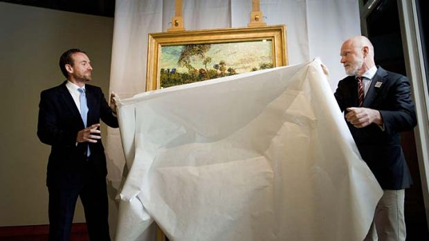 'Sunset at Montmajour': Director of the Van Gogh Museum in Amsterdam, Alex Ruge, left, and researcher Louis van ...
