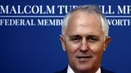 Malcolm Turnbull, former Liberal Party leader and the communications spokesman for the Liberal-led coalition, smiles as ...