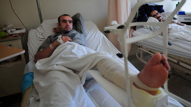 Ahmad Berro, who just arrived at Tripoli Public Hospital, was injured in the fighting between pro-and anti-regime ...