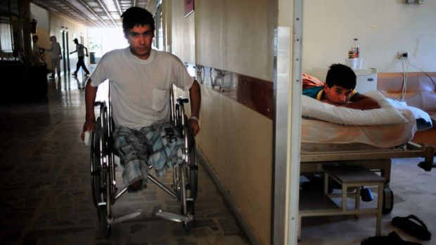 Nineteen-year-old Abu Saleh, who lost both his legs in the battle for Qusayr in Syria, in a wheelchair in a hospital in ...