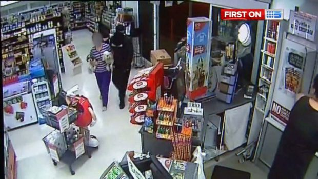 Armed robbers terrorise a woman during a hold-up in Logan.
