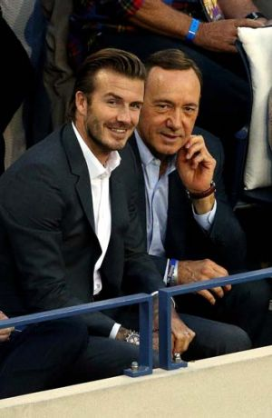 Kevin Spacey and David Beckham watch the men's singles final match.