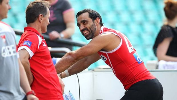 Adam Goodes shares a laugh with club doctor Nathan Gibbs at training on Tuesday.
