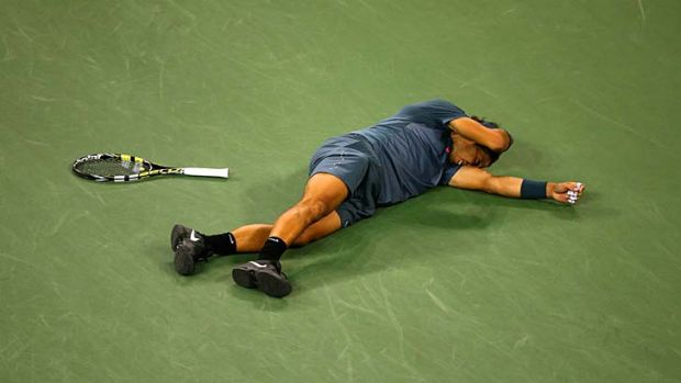 Phenomenon: Rafael Nadal slumps to the court after claiming his 13th grand slam title at the US Open.
