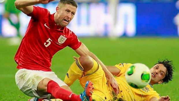 England defender Gary Cahill tangles with Edmar.