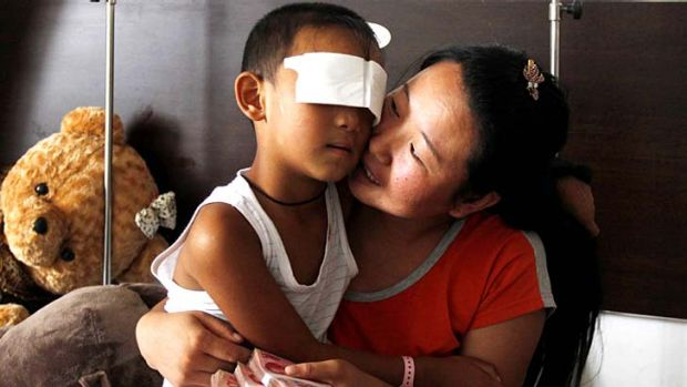Guo Bin, known as Bin-Bin, with his mother in a hospital in Taiyuan, north China's Shanxi province.