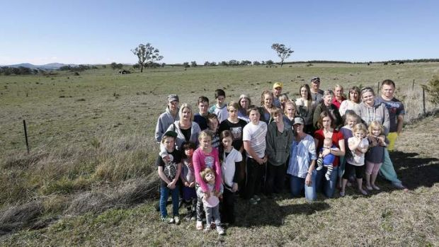 Uriarra village residents in front of the proposed site for a solar farm across the road to Uriarra Village.
