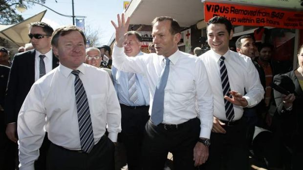 Opposition Leader Tony Abbott walks the streets of Liverpool, NSW with Kent Johns (left) , Liberal candidate for Werriwa.