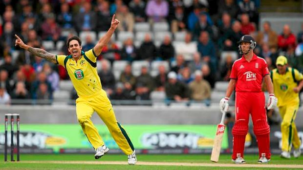 Mitchell Johnson of Australia celebrates dismissing Kevin Pietersen.