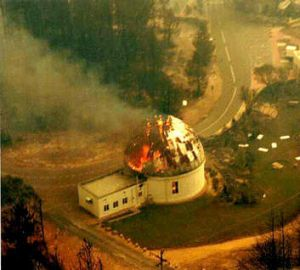 The iconic Mount Stromlo observatory burns during the Canberra bushfires.